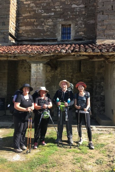 Sharon, Jerry, and I with another Pilgrim -  outside The Abbey, that is being restored.